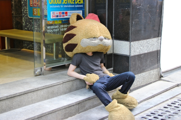 It's HOT in Korea!  Garfield not only forgot his body in the heat, but I think he passed out.
