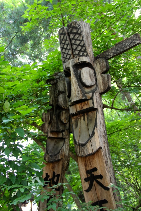 Totem poles at the entrance of every village to ward off evil spirits.