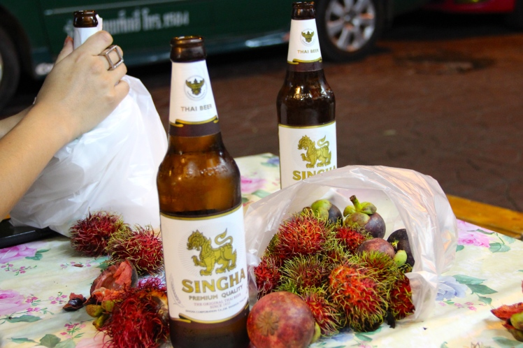 YUM! The beginning of our go-to snack for our entire trip- mangosteen, rambutan, and beer!